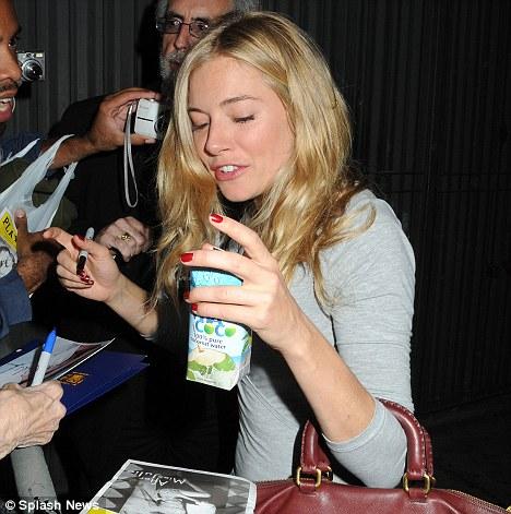 Siena Miller drinking Vita Coco